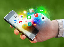 Hand holding smartphone with colorful app icons Stock Photography