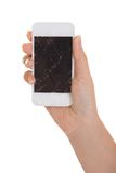 Hand holding smartphone with cracked screen Stock Photography
