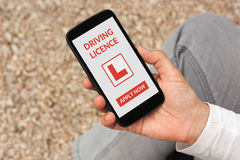 Hand holding smartphone with driving licence application mock up Royalty Free Stock Photos