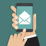 Hand holding smartphone with email icon. Vector illustration Royalty Free Stock Photo