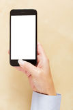Hand holding smartphone with empty white screen Stock Images