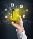 Hand holding smartphone with golden screen Stock Photo