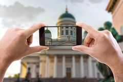 Hand holding Smartphone in Helsinki, Finland Royalty Free Stock Image