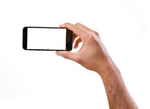 Hand holding Smartphone in horizontal on white background Royalty Free Stock Photo