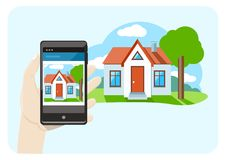 Hand holding smartphone with house sale offer Stock Images
