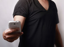 Hand holding smartphone Royalty Free Stock Photos