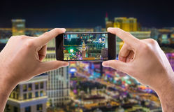 Hand holding Smartphone in Las Vegas, USA.  stock photography