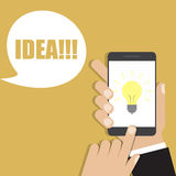 Hand holding smartphone with lightbulb icon. Vector illustration Stock Photography