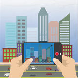 Hand holding a smartphone and makes photo cityscape Royalty Free Stock Photo