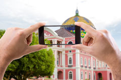 Hand holding smartphone in Manaus, Brazil Royalty Free Stock Photo