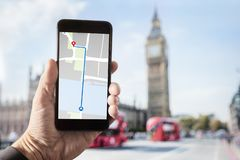 Hand holding smartphone with map on screen in London royalty free stock photos