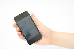 Hand Holding smartphone, mobile phone. Hand holding smart phone with blank screen royalty free stock photo