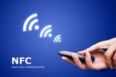 Hand holding smartphone with NFC technology - near field communi Stock Photo