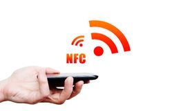 Hand holding smartphone with NFC technology - near field communi Royalty Free Stock Images