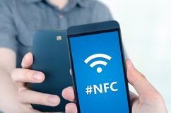 Hand holding smartphone with NFC technology Stock Photos