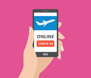 Hand holding smartphone with online check in button and airplane icon on screen. Concept of mobile application. Stock Photography