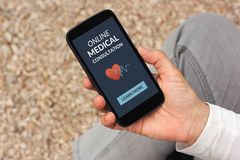 Hand holding smartphone with online medical consultation concept. On screen. All screen content is designed by me Royalty Free Stock Photos