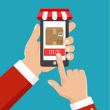 АHand holding smartphone with parcel. Order goods from smartphone Stock Photography