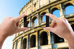 Hand holding Smartphone in Rome, Italy Royalty Free Stock Images