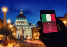 Hand holding smartphone with Rome St Peter Vatican city backgrou stock image