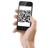 Hand Holding a Smartphone scanning qrcode. Studio Shoot of a adult man's hand holding a generic smartphone scanning a Qrcode Royalty Free Stock Images