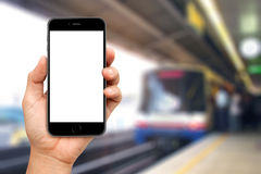 Hand are holding Smartphone with sky train Stock Photo