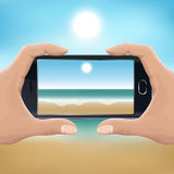 Hand holding smartphone and taking photo of the beach. Two hands holding smartphone on beach horizontally, and making photo of the sea. Vector illustration for Stock Images