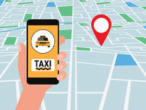 Hand holding smartphone. Taxi service application on a screen and location pointer on street map. Smart taxi service concept. Royalty Free Stock Images