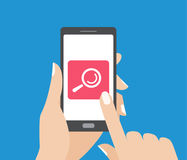 Hand holding smartphone and touching the screen with search button. Magnifying glass icon. vector illustration