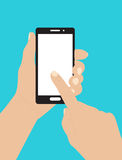 Hand holding smartphone and touching the screen Royalty Free Stock Images