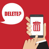 Hand holding smartphone with trash bin icon. Delete concept Stock Images
