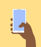 Hand holding Smartphone. Vector illustration in flat design style. Royalty Free Stock Photography