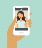 Hand holding smartphone during a video call Stock Photos
