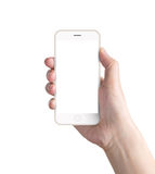 Hand holding the smartphone. Hand holding the white smartphone royalty free stock photos