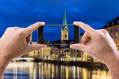 Hand holding Smartphone in Zurich, Switzerland Stock Photography