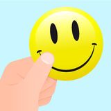 Hand holding a smiley face. Hand holding a yellow smiley face vector illustration