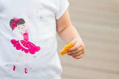 Hand holding snack. Child hand holding snack royalty free stock image