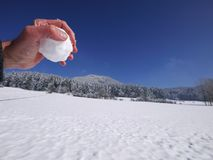 Hand holding snow ball. Holding snow ball in one hand Royalty Free Stock Images