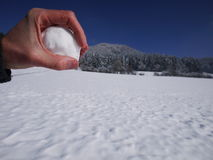Hand holding snow ball. Holding snow ball in one hand Stock Image