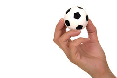 Hand holding soccer ball Royalty Free Stock Image