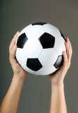 Hand holding soccer ball Royalty Free Stock Photo