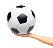 Hand holding soccer ball isolated on white Stock Images