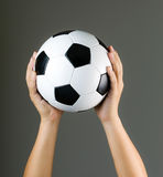 Hand holding soccer ball Royalty Free Stock Images