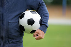 Hand holding soccer ball Royalty Free Stock Photography
