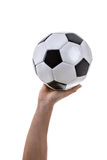 Hand holding a soccer ball on white background Stock Photos