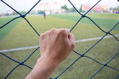Hand holding soccer net Royalty Free Stock Images