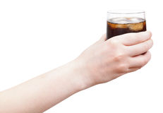 Hand holding soft drink with ice in glass Royalty Free Stock Photos