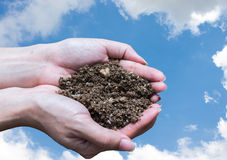 Hand holding soil,Hand dirty with soil Stock Photography
