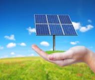 Hand holding solar panel. Stock Photo