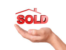 Hand holding sold house isolated on white background Stock Image